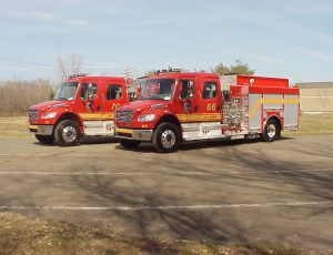 Side mount pumpers on a Freightliner Chassis